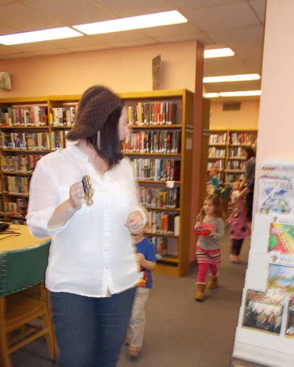 Ms. Jamie leading the Story Hour Parade